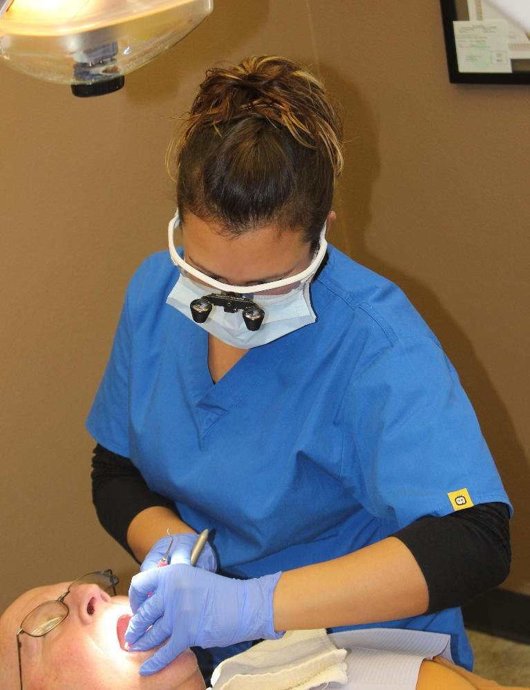 Another one of our awesome Hygienists helping a patient!